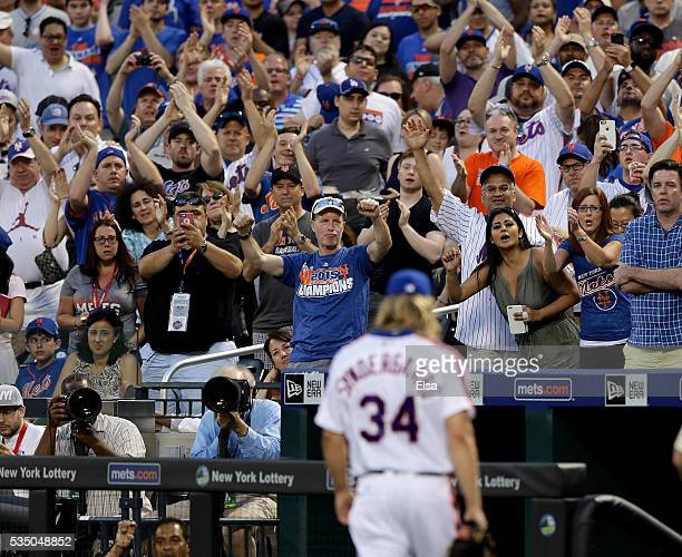 Fans cheer for Noah Syndergaard of the New York Mets after he was tossed from the game for brushing back Chase Utley of the Los Angeles Dodgers in...