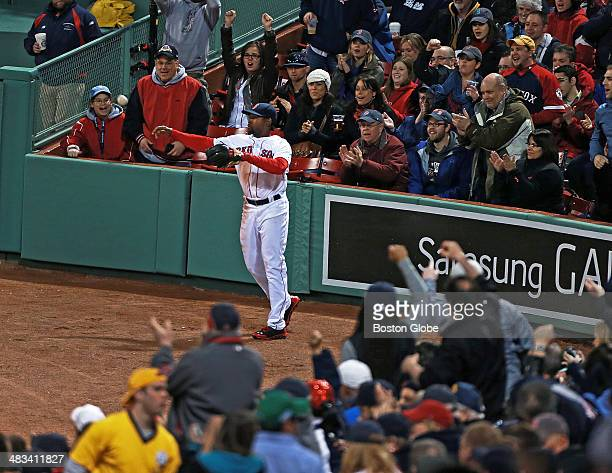 Fans cheer for Red Sox right fielder Jackie Bradley Jr as he fires the ball back to the infield after he made a running catch in the third inning The...