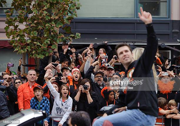 Fans cheer for San Francisco Giants catcher Buster Posey during a parade to celebrate the team's 2012 World Series Championship in downtown San...