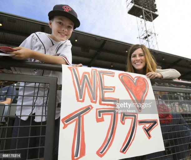 Fans cheer for Seattle Mariners pitcher Hisashi Iwakuma with a banner as he pitches for TripleA Tacoma against Salt Lake in Tacoma Washington on June...