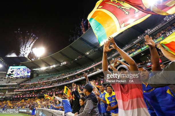 Fans cheer for Sri Lanka during the first International Twenty20 match between Australia and Sri Lanka at Melbourne Cricket Ground on February 17...