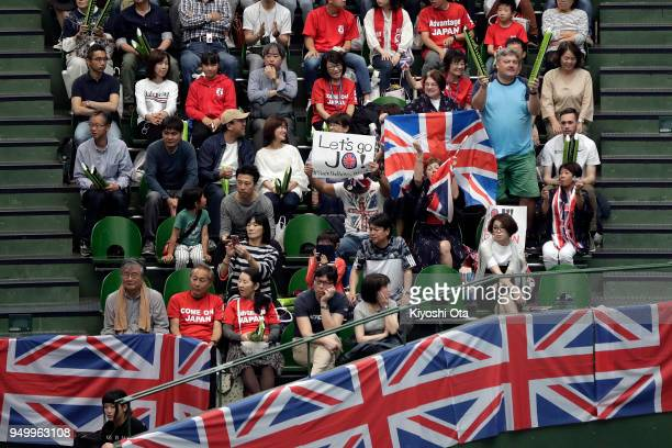 Fans cheer for Team Great Britain during the singles match between Naomi Osaka of Japan and Johanna Konta of Great Britain during day two of the Fed...