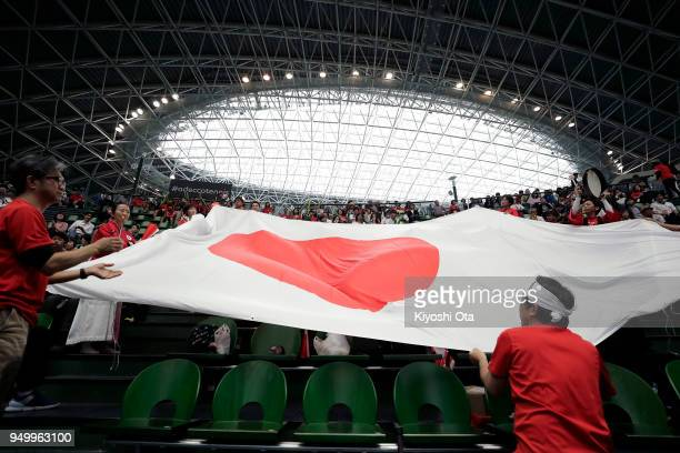 Fans cheer for Team Japan ahead of the singles match between Naomi Osaka of Japan and Johanna Konta of Great Britain during day two of the Fed Cup...