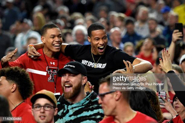 MINNEAPOLIS MN Fans cheer for Texas Tech late in the second half of the NCAA Final Four men's basketball game against Michigan State at US Bank...