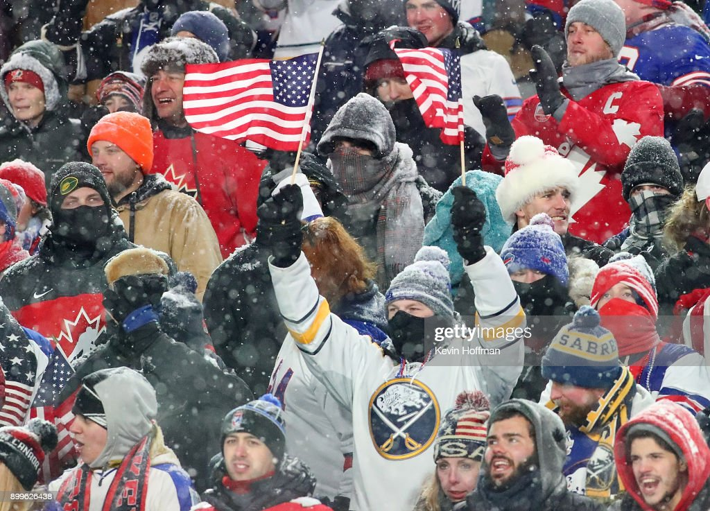 Fans cheer for the United States during the IIHF World Junior Championship against Canada at New Era Field on December 29, 2017 in Buffalo, New York. The United States beat Canada 4-3.
