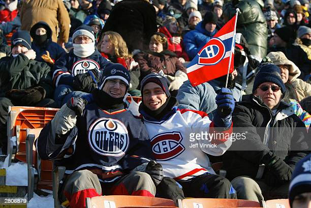 Fans cheer for their team as the Edmonton Oilers and the Montreal Canadiens play in the Molson Canadien Heritage Classic Megastars Game on November...