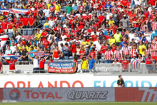Fans cheer for their team during a group A match between Costa Rica and Paraguay at Camping World Stadium l as part of Copa America Centenario US...