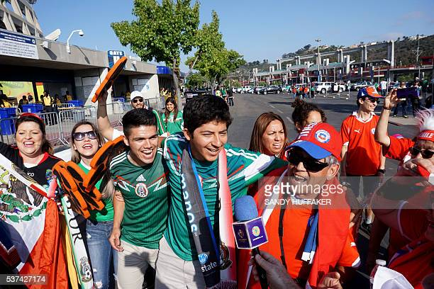 Fans cheer for their teams before the start of the Mexico vs Chile soccer match at Qualcomm Stadium in San Diego California on Wednesday June 1 2016...