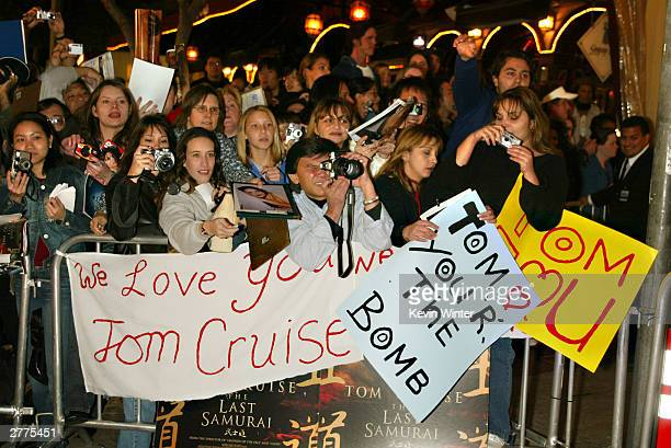 Fans cheer for Tom Cruise at the WB's premiere of The Last Samurai at the Mann's Village Theatre December 1 2003 in Los Angeles California