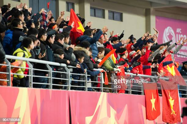 Fans cheer for Vietnam team during the AFC U23 Championship Group A match between Vietnam and Australia at Kunshan Stadium on January 14 2018 in...