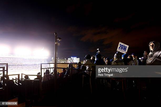 Fans cheer from a rooftop during Game 5 of the 2016 World Series between the Cleveland Indians and the Chicago Cubs at Wrigley Field on Sunday...