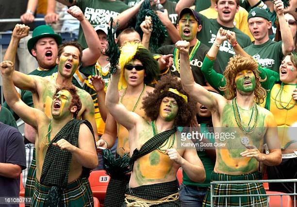 CSU_CU CSU fans cheer from the stands some covered in green and yellow paint at the 2007 Qwest Rocky Mountain Showdown between the University of...