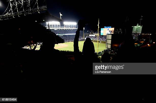 Fans cheer from the Wrigley rooftops during Game 3 of the 2016 World Series between the Cleveland Indians and the Chicago Cubs at Wrigley Field on...