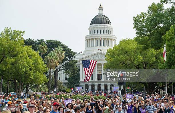 Fans cheer in front of the state capitol building during a celebration honoring Anthony Sadler Alek Skarlatos and Spencer Stone in Sacramento...