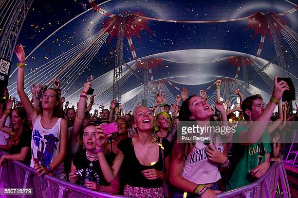 Fans cheer in the front rows of the crowd at the Lowlands Festival at Evenemententerrein Walibi World, Biddinghuizen, Netherlands, 22 August 2015.