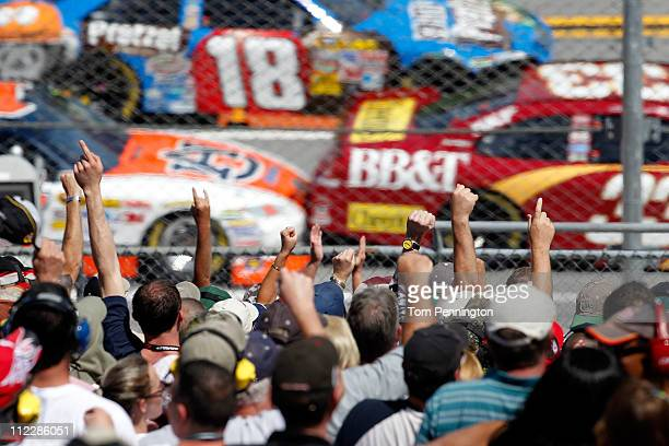Fans cheer in the grandstand during the NASCAR Sprint Cup Series Aaron's 499 at Talladega Superspeedway on April 17 2011 in Talladega Alabama