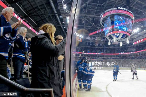 Fans cheer in the stands as Winnipeg Jets celebrate a first period goal against the Chicago Blackhawks at the Bell MTS Place on December 11 2018 in...