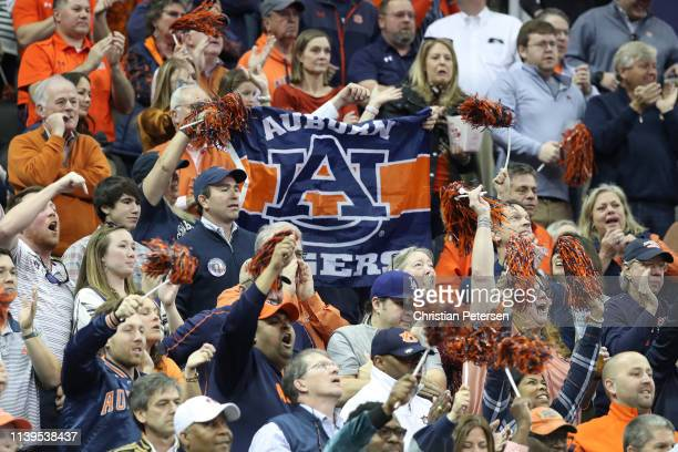 Fans cheer in the stands during the 2019 NCAA Basketball Tournament Midwest Regional between the Kentucky Wildcats and the Auburn Tigers at Sprint...