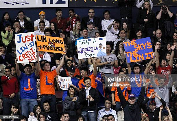 Fans cheer Jeremy Lin of the New York Knicks against the Toronto Raptors at the Air Canada Centre February 14 2012 in Toronto Ontario Canada NOTE TO...