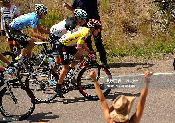 Fans cheer leader Levi Leipheimer as he nears the top of a hill onthe course The course had an elevation gain of 5000 vertical feet Just in back of...