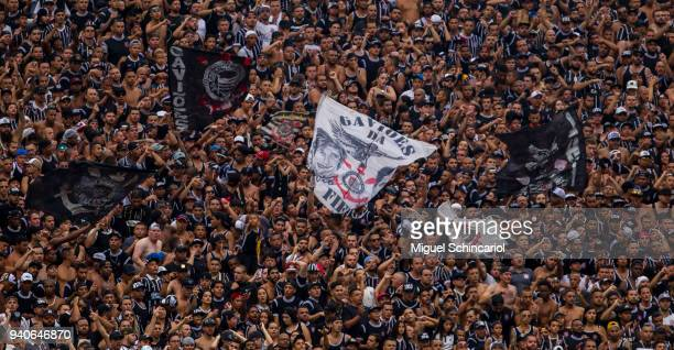 Fans cheer of Corinthians team during a first match between Corinthians and Palmeiras in the final of the Paulista Championship 2018 at Arena...