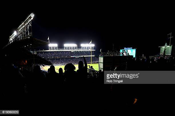 Fans cheer on a rooftop during Game 5 of the 2016 World Series between the Cleveland Indians and the Chicago Cubs at Wrigley Field on Sunday October...