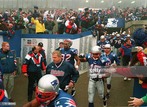 Fans cheer on Bill Parcells and the New England Patriots as they go on to the field before playing the Pittsburgh Steelers in the playoffs