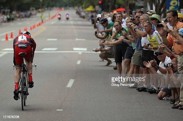 Fans cheer on Cadel Evans of Australia riding for BMC Racing as he races to ninth place in the Prologue of the 2011 USA Pro Cycling Challenge on...