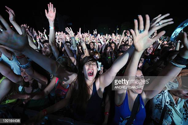 Fans cheer on Jarvis Cocker of English alternative rock band Pulp during the EXIT festival in Novi Sad on July 8 2011 More than 150 acts are lined up...