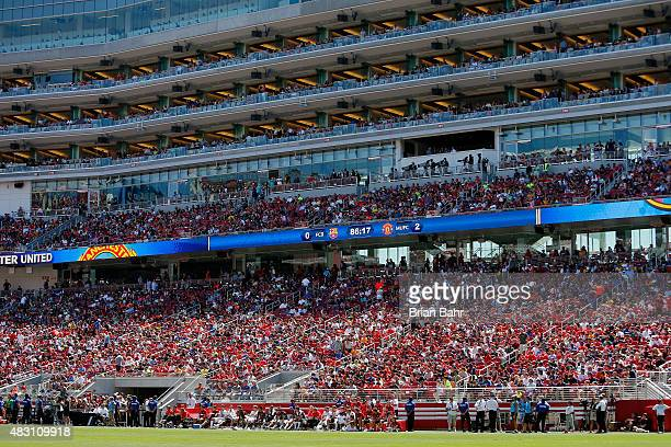 Fans cheer on Manchester United FC and FC Barcelona in the second half during the International Champions Cup on July 25 2015 at Levi's Stadium in...