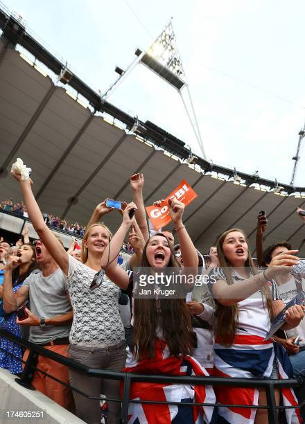 Fans cheer on Mo Farah of Great Britain in the Men's 3000m during day two of the Sainsbury's Anniversary Games IAAF Diamond League 2013 at The Queen...