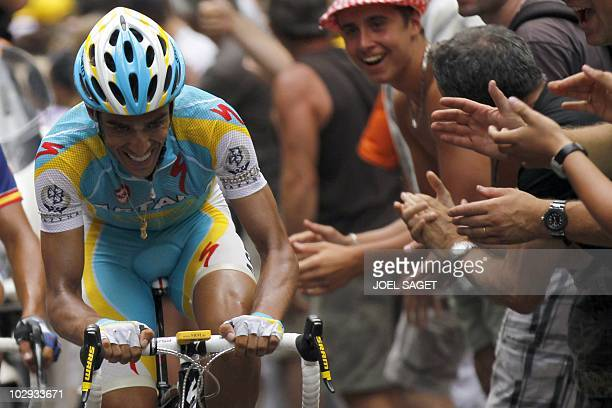 Fans cheer on Spain's Alberto Contador during the 210,5 km and 12th stage of the 2010 Tour de France cycling race run between Bourg-de-Peage and...