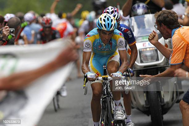 Fans cheer on Spain's Joaquim Rodriguez rides behind Spain's Alberto Contador before winning the 210,5 km and 12th stage of the 2010 Tour de France...
