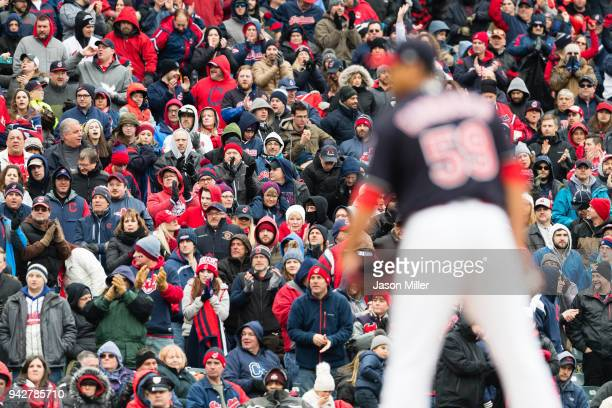 Fans cheer on starting pitcher Carlos Carrasco of the Cleveland Indians during the sixth inning against the Kansas City Royals at Progressive Field...