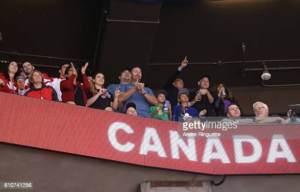 Fans cheer on Team Canada after scoring a first period goal on Team Europe during Game One of the World Cup of Hockey final series at the Air Canada...