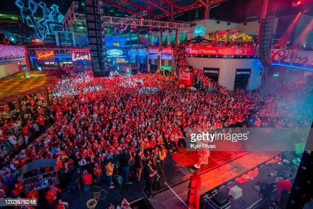 Fans cheer on the Chiefs at the Power and Light District as the Kansas City Chiefs play the San Francisco 49ers in the Super Bowl on February 2, 2020...