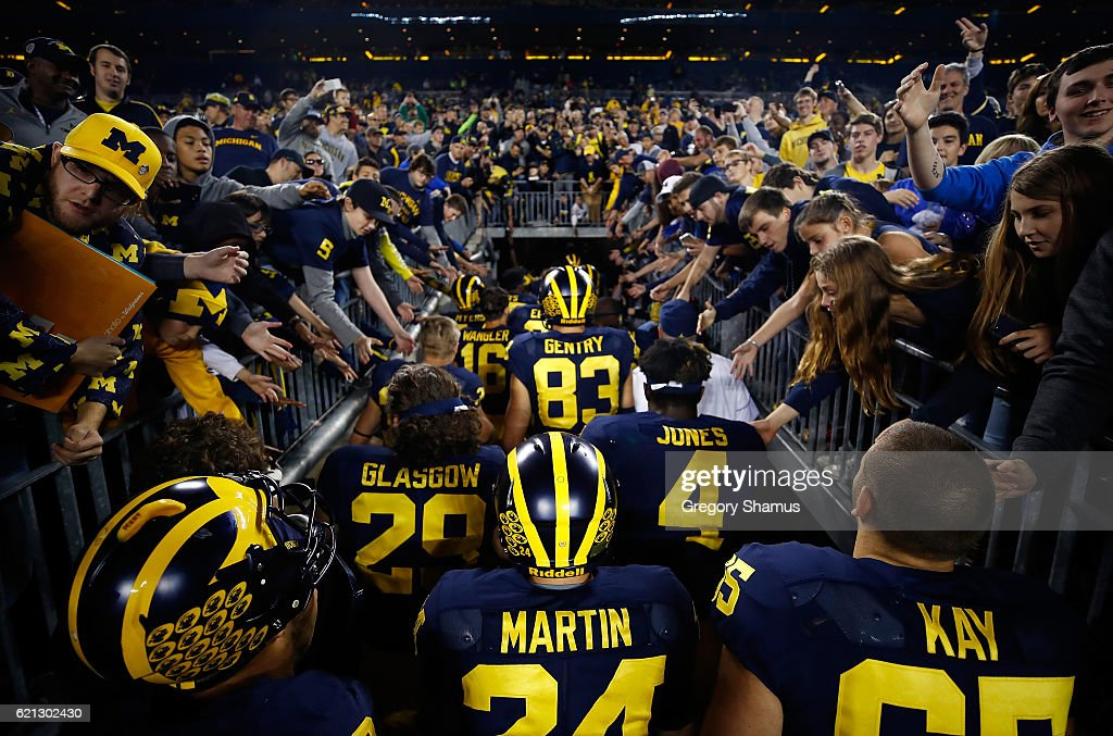 Fans cheer on the Michigan Wolverines as they leave the field after a 59-3 win over the Maryland Terrapins on November 5, 2016 at Michigan Stadium in Ann Arbor, Michigan.