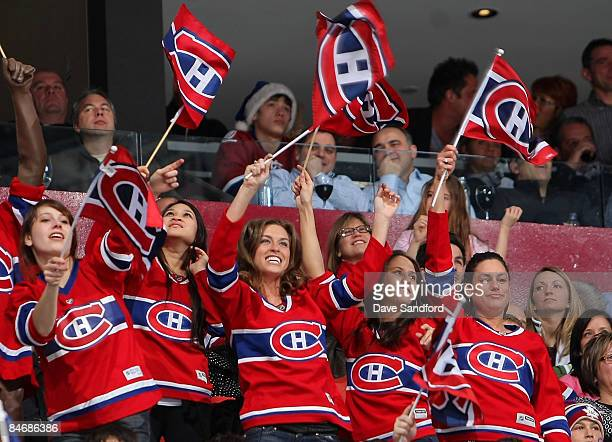 Fans cheer on the Montreal Canadiens as they face the Toronto Maple Leafs during their NHL game at the Bell Centre February 7 2009 in Montreal Quebec