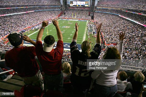 Fans cheer on the New England Patriots against the New York Giants during Super Bowl XLII on February 3 2008 at the University of Phoenix Stadium in...