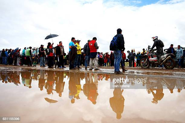 Fans cheer on the riders as they depart the camp after stage six of the 2017 Dakar Rally between Oruro and La Paz was cancelled due to weather...