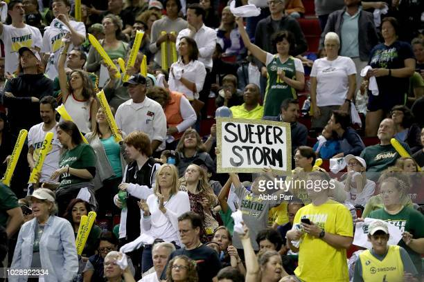 Fans cheer on the Seattle Storm as they take on the Washington Mystics during game one of the WNBA Finals at KeyArena on September 7 2018 in Seattle...