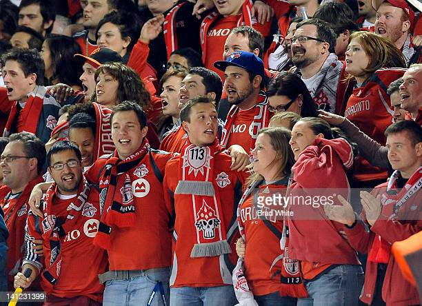 Fans cheer on the Toronto FC during CONCACAF Champions League game action against the Los Angeles Galaxy March 7, 2012 at the Rogers Centre in...