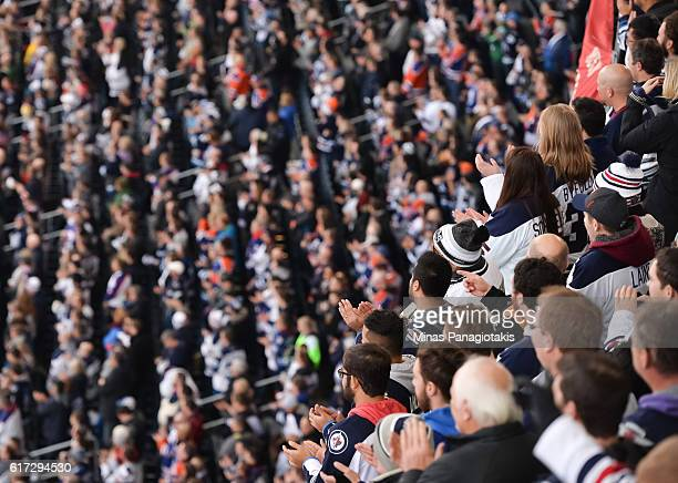 Fans cheer on the Winnipeg Jets and Edmonton Oilers alumni during the 2016 Tim Hortons NHL Heritage Classic alumni game at Investors Group Field on...