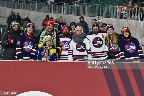 Fans cheer on the Winnipeg Jets in advance of the 2019 Tim Hortons NHL Heritage Classic as the Calgary Flames take on the Winnipeg Jets at Mosaic...