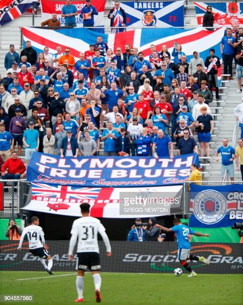 Fans cheer on their team as Alfredo Morelos of Scottish club Rangers FC plays a ball in from the side which resulted in a goal during the second half...
