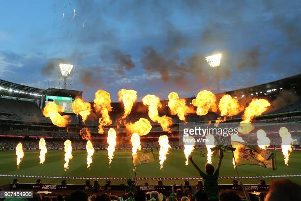 Fans cheer on their team during the Big Bash League match between the Melbourne Stars and the Sydney Thunder at Melbourne Cricket Ground on January...