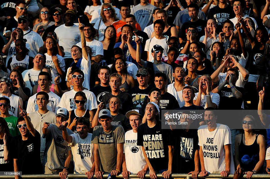 Fans cheer or the Penn State football team during a pep rally at Beaver Stadium on August 31, 2012 in State College, Pennsylvania. Penn State will play it's first game under new head coach Bill O'Brien against Ohio University on September 1 following the death of former coach Joe Paterno.