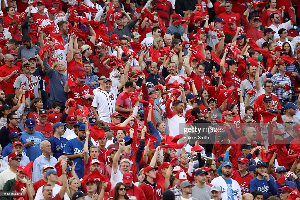 Fans cheer prior to game one of the National League Division Series between the Los Angeles Dodgers and the Washington Nationals at Nationals Park on October 7, 2016 in Washington, DC.