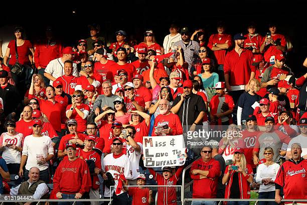 Fans cheer prior to game one of the National League Division Series between the Los Angeles Dodgers and the Washington Nationals at Nationals Park on...