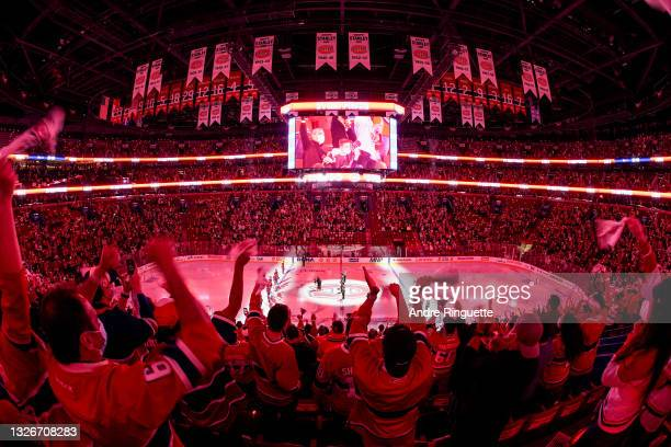 Fans cheer prior to Game Three of the 2021 NHL Stanley Cup Final between the Tampa Bay Lightning and the Montreal Canadiens at Bell Centre on July...